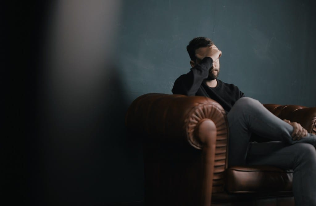 Man sitting in a chair stressed