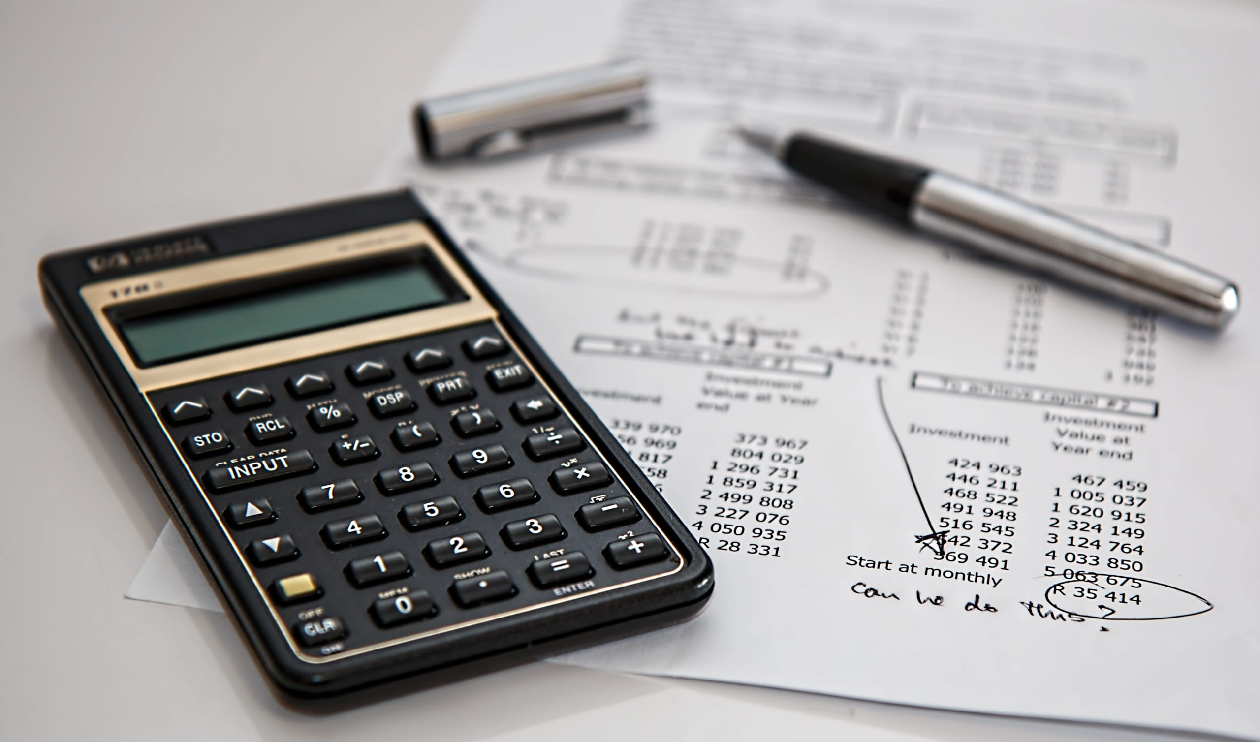 Black calculator and tax investment sheet