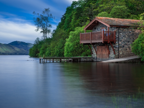 Cottage hanging over loch in scotland