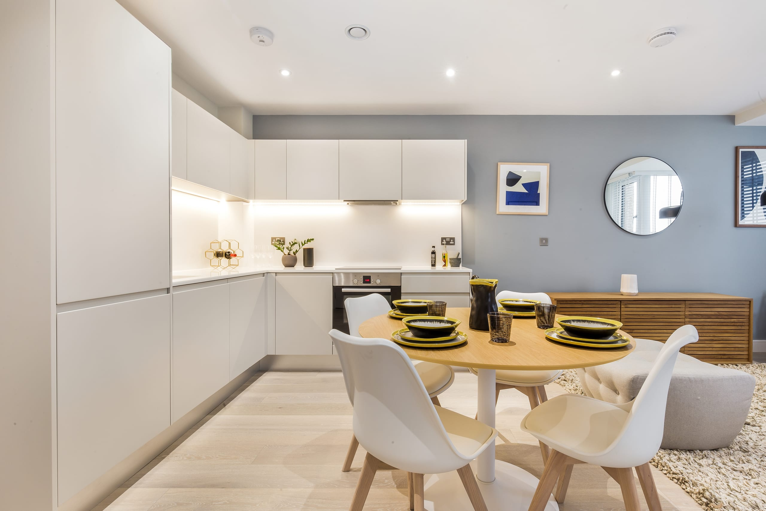 White kitchen and dining table with white chairs